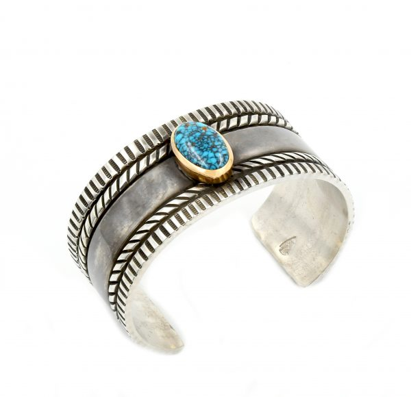 Sterling silver bracelet with a turquoise inlay.