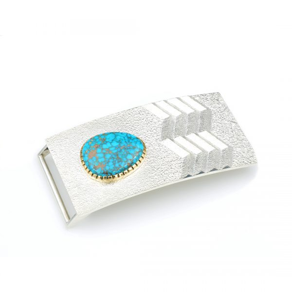 A silver belt buckle with a turquoise inlay